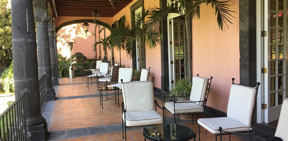 The lovely breakfast terrace overlooks the hotel's perfectly manicured gardens.