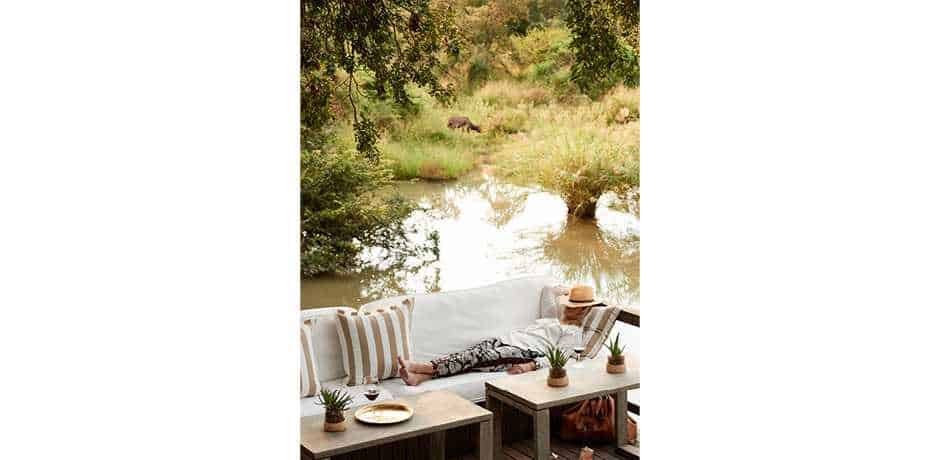 Relaxing on the main deck at The Farmstead at Royal Malewane, South Africa. Courtesy the Royal Portfolio.