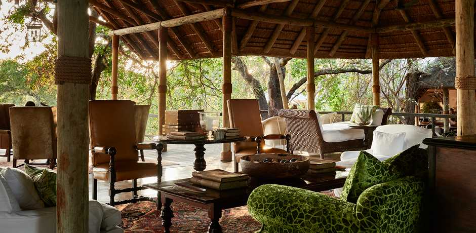 The lounge in the main lodge at The Farmstead at Royal Malewane, South Africa. Courtesy the Royal Portfolio.