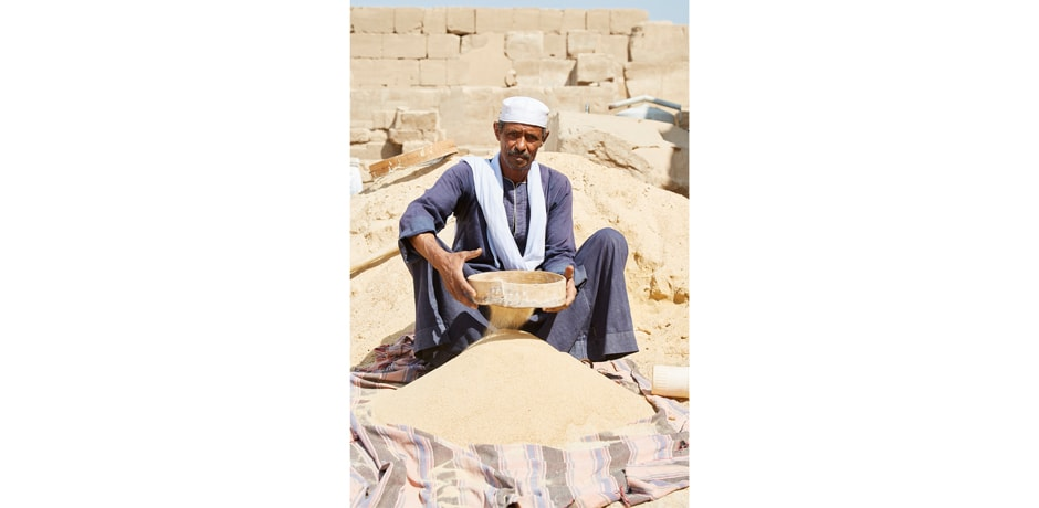 """""""This man was sifting sand outside of the Step Pyramid. What struck me was his ability to hold my gaze with a calm confidence. Some people just do not want their photos taken, or will look away. When someone holds your gaze, it says a lot about their own confidence and makes me feel like we actually connect, for a moment. And I feel that they played a part in making their own picture, as opposed to me just taking one of them."""""""