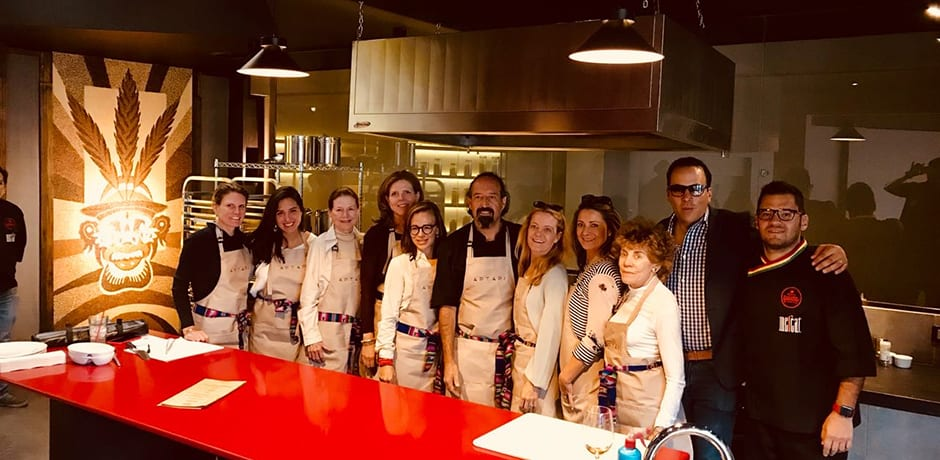 Melissa and members of the Indagare Journey pose for a photo with chef Marco Boniface (center) at Aptapi Restaurant