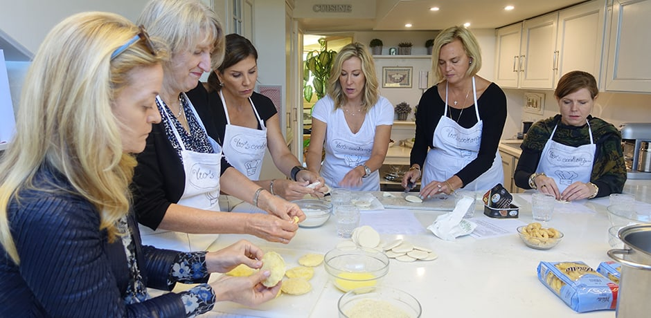 Some of the group learns pasta making in a cooking class in a private home.