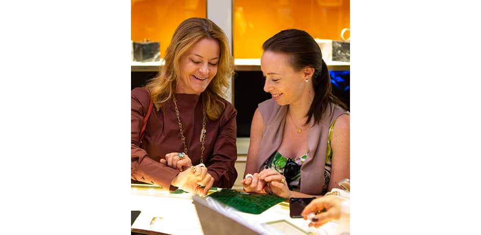 Our Vogue x Indagare hosts—Indagare founder Melissa Biggs Bradley and Vogue Director of Fashion Initiatives Rickie De Sole—try on jewelry in the Bvlgari headquarters.