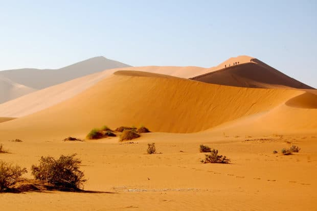 Hiking the sand dunes of Namibia.