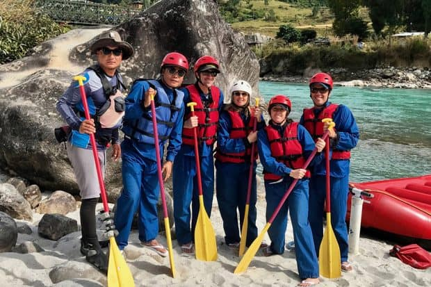 The group whitewater rafting in Bhutan