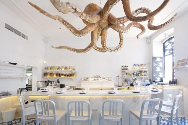 A Cevicheria restaurant bar area with octopus ceiling decoration in Lisbon Portugal