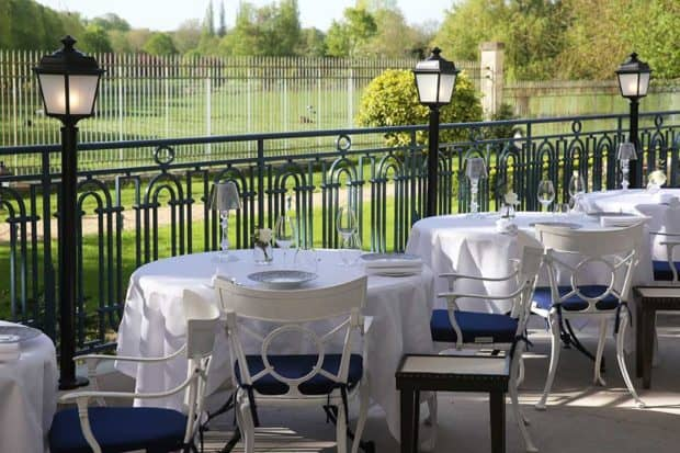 The terrace at La Veranda at Waldorf Astoria Trianon Palace