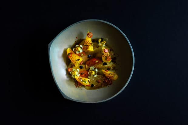 A dish of pineapple, yuzu flowers and caramelized kelp oil at Inua in Tokyo, Courtesy Jason Loucas