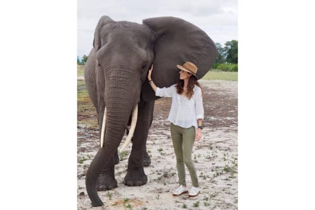 Operations Manager Rose Allen meeting an elephant at Abu Camp while scouting in Botswana.