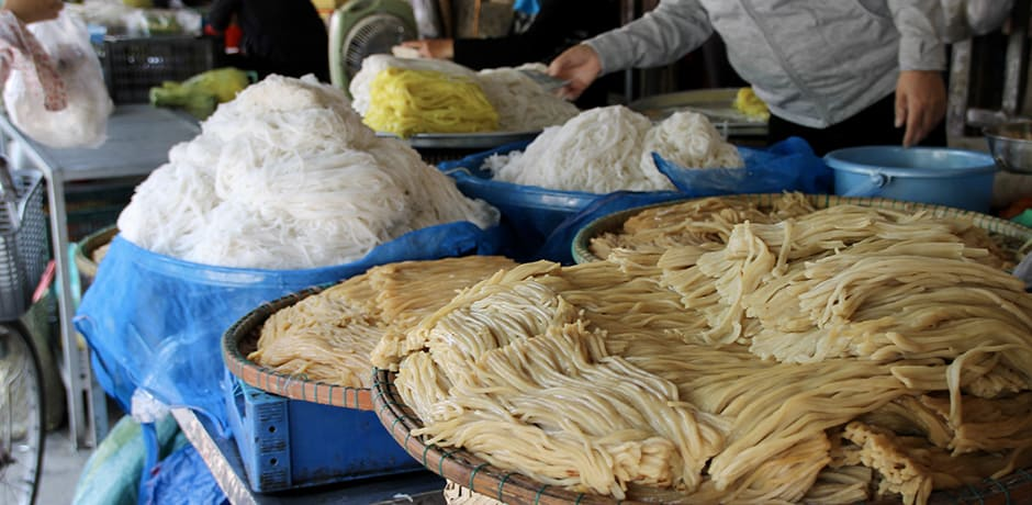 Fresh noodles for sale at the market in Hoi An