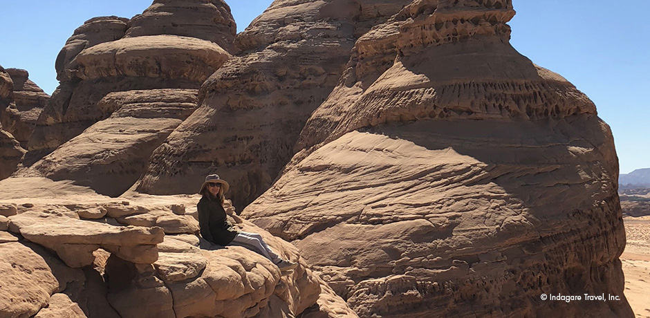 Melissa on a rock in the area of  al-Diwan in Mada'in Saleh