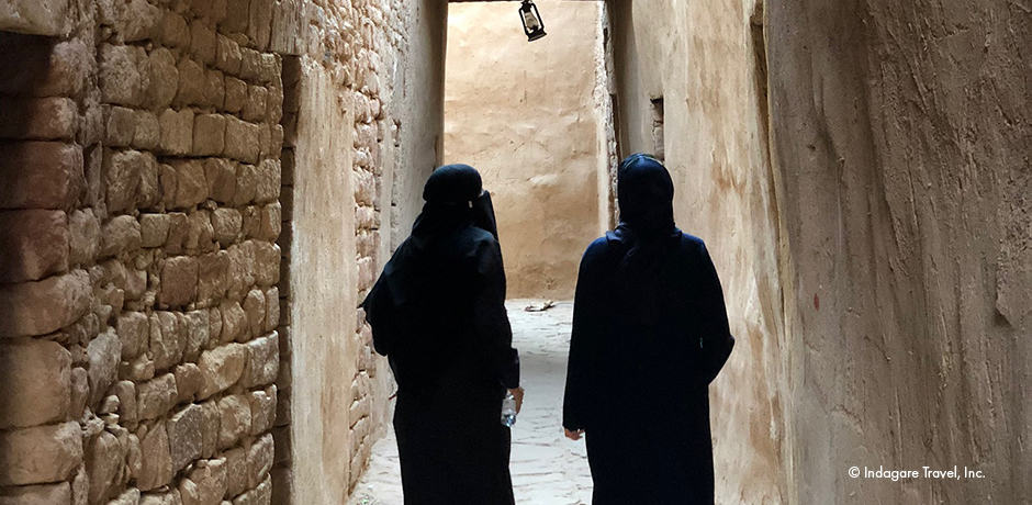 Touring the maze of Al-`Ula's ancient village with locals whose families lived within its walls for more than 500 years