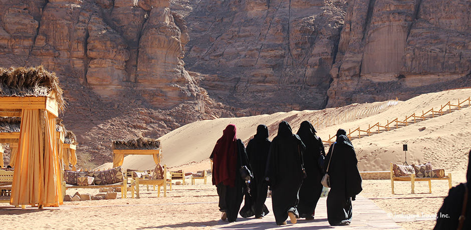 A group of locals walking in Al-`Ula