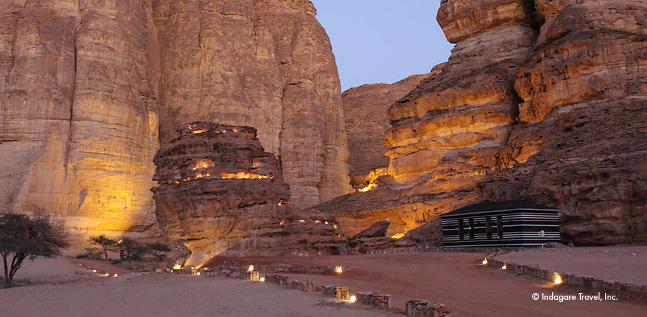 The area's top desert camp is tucked into a dramatic rock canyon and lit up each night with hundreds of lights.