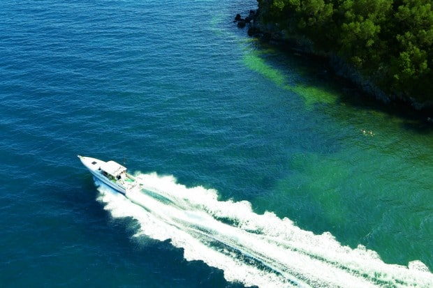 Aerial view of motorized yacht in water off of Corfu in Greece