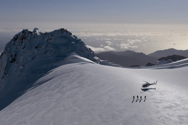 Helicopter with 4 heli-skiiers at Glacier Southern Lakes in New Zealand