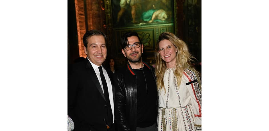 WSJ. Magazine's publisher Anthony Cenname (left) and editor-in-chief Kristina O'Neill (right) invited the who's who of Milan and the design world to a dinner in a deconsecrated church for the magazine's annual Salone del Mobile party. Here, the pair pose with Gucci's Worldwide Communications Director Alessio Vannetti. © The Wall Street Journal, André Lucat/SGP.