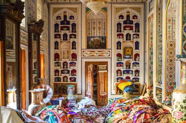 Shopping for textiles on the 2019 Insider Journey to Uzbekistan with designer John Robshaw