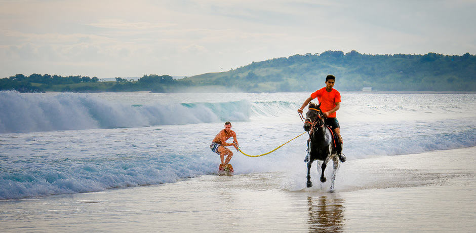 Wakeboarding behind a horse at Nihi Sumba, Indonesia.