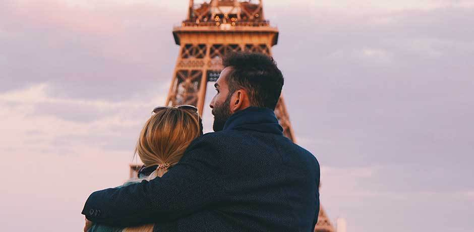 A couple in front of the Eiffel Tower in Paris