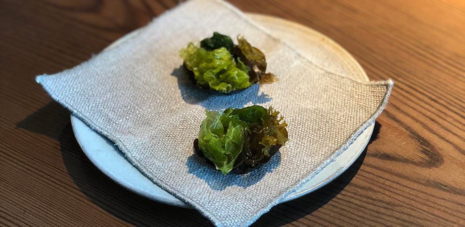 Fourth course: Fresh seaweeds. Kelp tart stuffed with herbs and cream served on a hemp napkin.