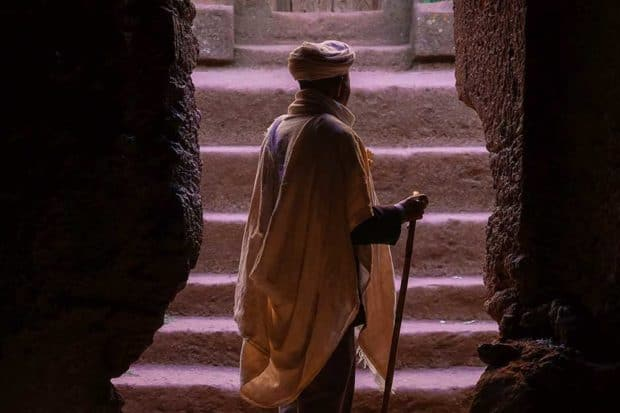 A man in the entryway of a church in Lalibela
